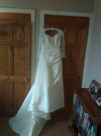 Off white satin bridal dress with train. Used once and commercially dry cleaned. Size 12-14