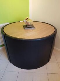 Circular dining table and leather chairs