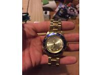 Invicta gold diving watch.