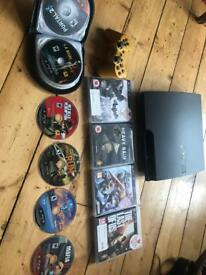 PS3 with controller and 10 games
