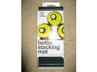 Mode, Fridge Monkey bottle stacking mat, new un-used in original packaging.