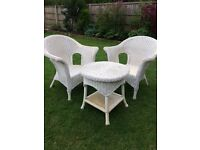 White wicker chairs and table