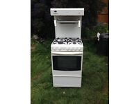 Gas Cooker Cannon Winchester white freestanding with eye level grill. Used but clean.
