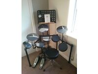 Alesis DM Nitro Electronic Drum Kit with music stand and stool