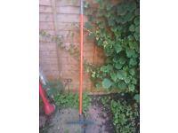 Durable garden rake with long handle