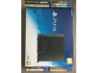 PS4 + 9 games (boxed)