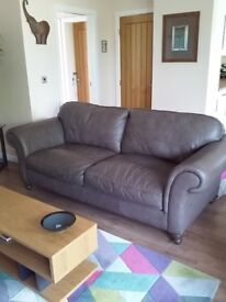 Grey leather sofa in good condition, less than 3 years old