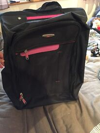 Black and pink travel hand luggage case