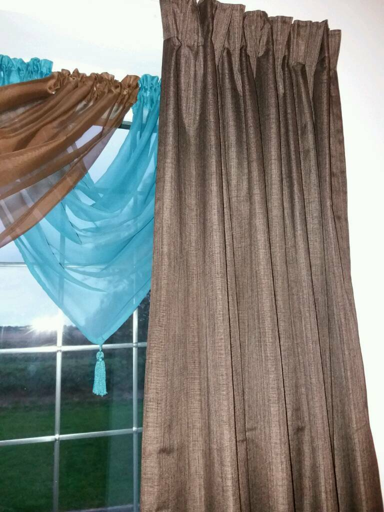 2 sets of Choc thermal curtains & voile swags