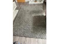 Silver grey shag pile rug