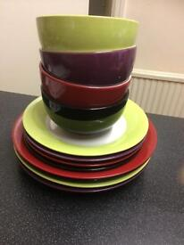 Colour coordinated dinner plates, side plates and bowls