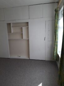 Large First floor flat in terraced house for rent.