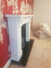 Wooden surround with cast iron inset