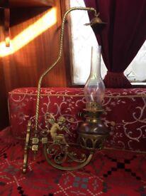 A pair of antique showmans bracket angel lamps