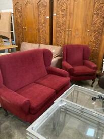 Red fabric two seater sofa and armchair set