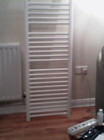 new white heated towel rail