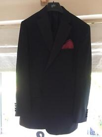 Black ex-rental dinner jacket and trousers with red cummerbund and bow tie