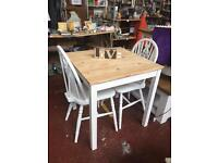 Small dining table and pair of wheel back chairs