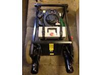 Remote control petrol lawn mower