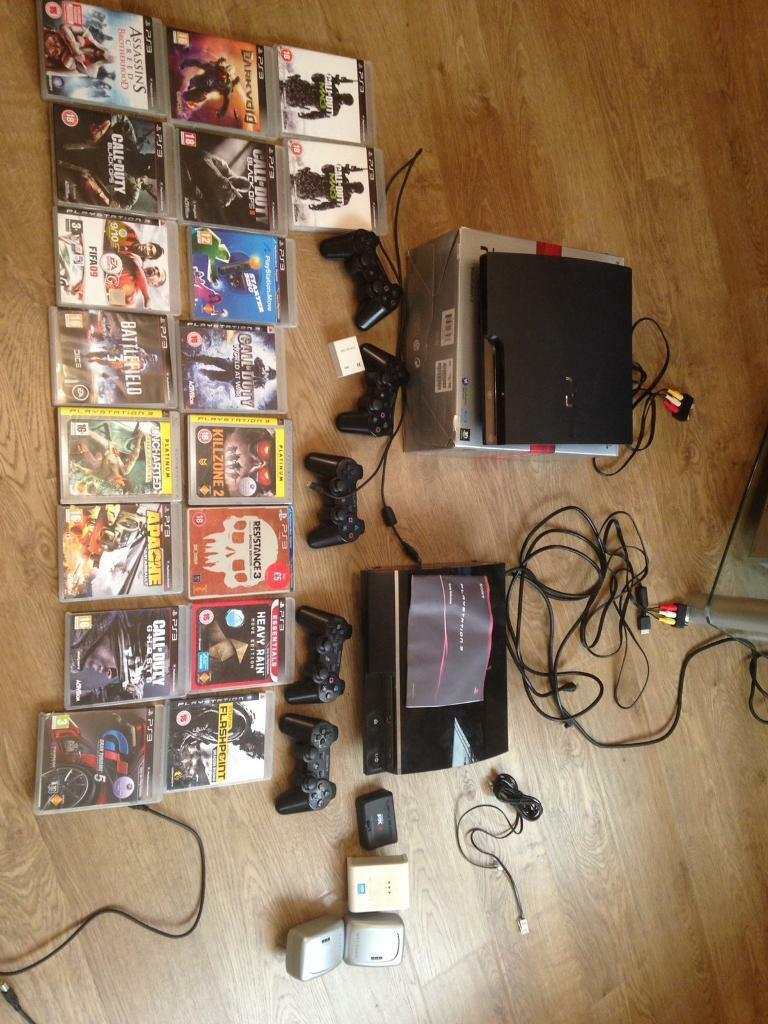 2 PS3s with games and controllers