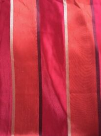 Beautiful brushed silk style long curtains. Montgomery vibrant reds and oranges