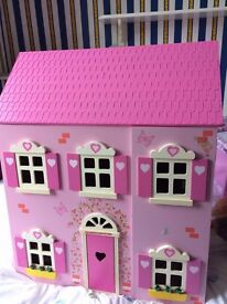 Lovely dolls house, hardly played with. Includes house and furniature