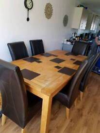 Solid oak extendable dining table with 6 high back leather chairs