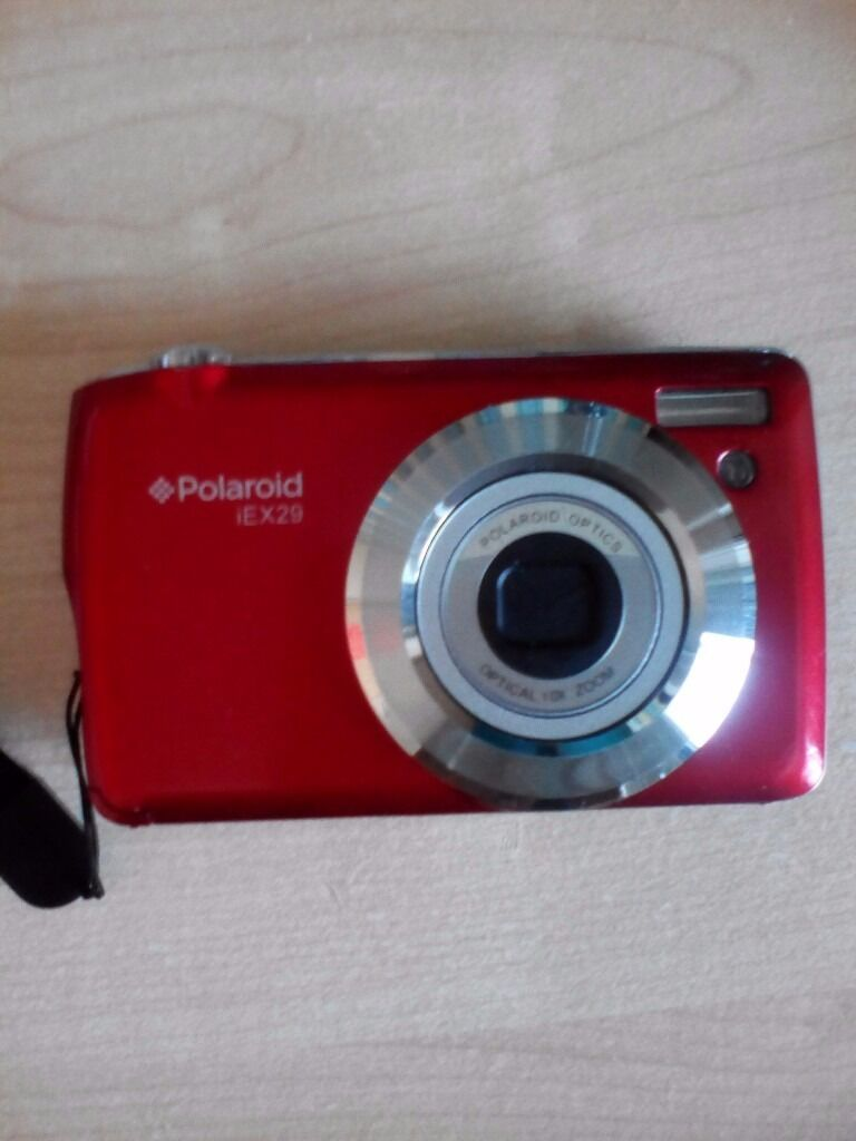 """Red Polaroid Digital Camerain Lancing, West SussexGumtree - Red Polaroid Digital Camera iE X29,18 Mega Pixels,2.7"""" Preview Screen,10 x Optical Zoom With Full Instructions,Wrist Strap,Purple Camera Case, Still Boxed & Charger, Will Need New SIM Card. Buyer Collects Please Thank You"""