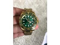 Rolex gmt 2 green face gold strap
