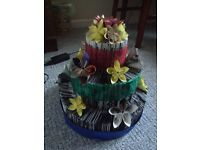 book folded 3 tier cake decorated with paper folded flowers,
