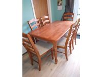 DINING TABLE AND 6 CHAIRS £90 ono