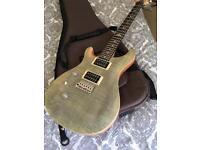 Left handed lefty PRS SE Custom Tampas Green guitar