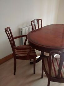 Extending dining table + 6 chairs for sale