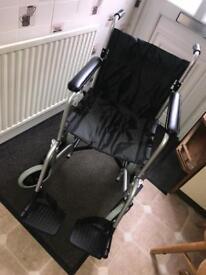 Portable lightweight folding wheelchair