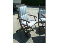 Two carver style garden chairs