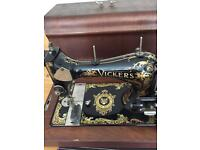 Antique vickers deluxe Ltd. sewing machine . With wooden case .