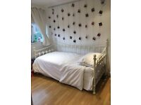 Cream metal Day bed with trundle plus two mattresses