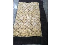 A plush velvet handmade quilt/throw