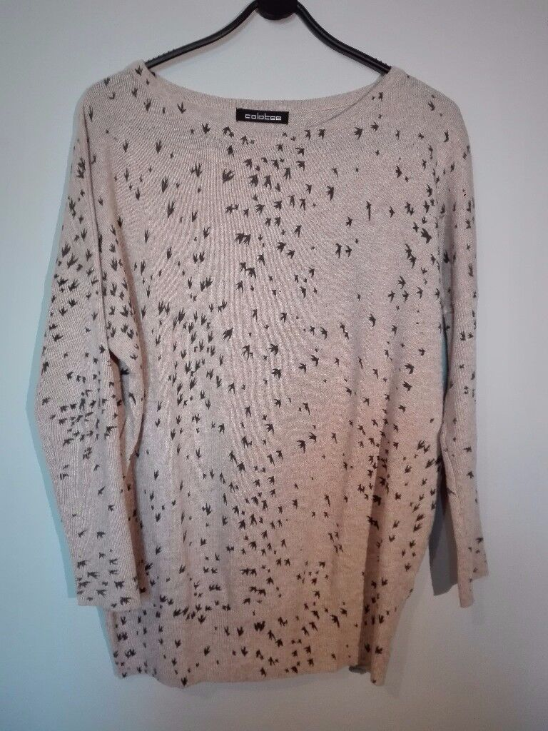 Cosy loose long sleeved jumper.