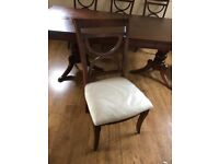 Wooden dining table with 8 chairs