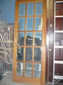 Solid wood interior door with 15 bevelled glass panes