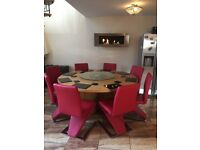Large round Oak dining table and 8 chairs