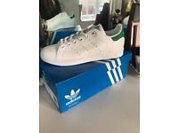Green and white Adidas Stan smiths