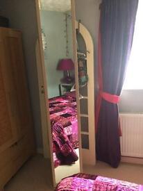 Tall mirrored storage unit