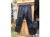 "Jeans, leather, men's. 36"" waist."