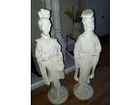 2 oriental statues.