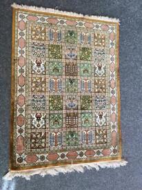 Small persian silk rug carpet