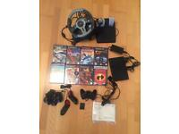 Sony Playstation 2 Slimline - With PS2 Games Bundle and Steering wheel