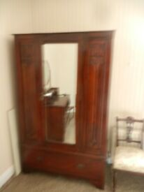 1950's solid wood triple wardrobe with mirrored door, carving detail and drawer at base