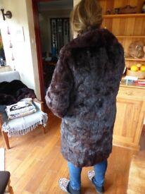 Warm dark brown fur coat size 12/14 and 100cm long
